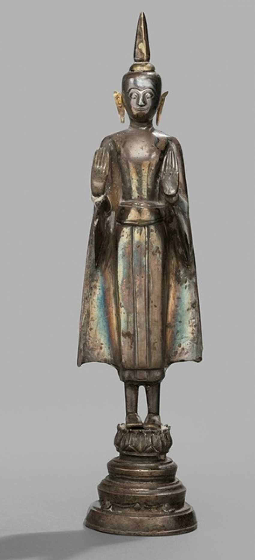 Sculpture of the standing Buddha Shakyamuni in silver metal-gear - photo 1