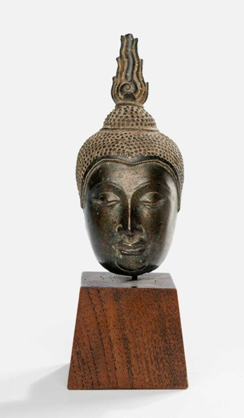 Fragment of a Buddha head made of Bronze - photo 1