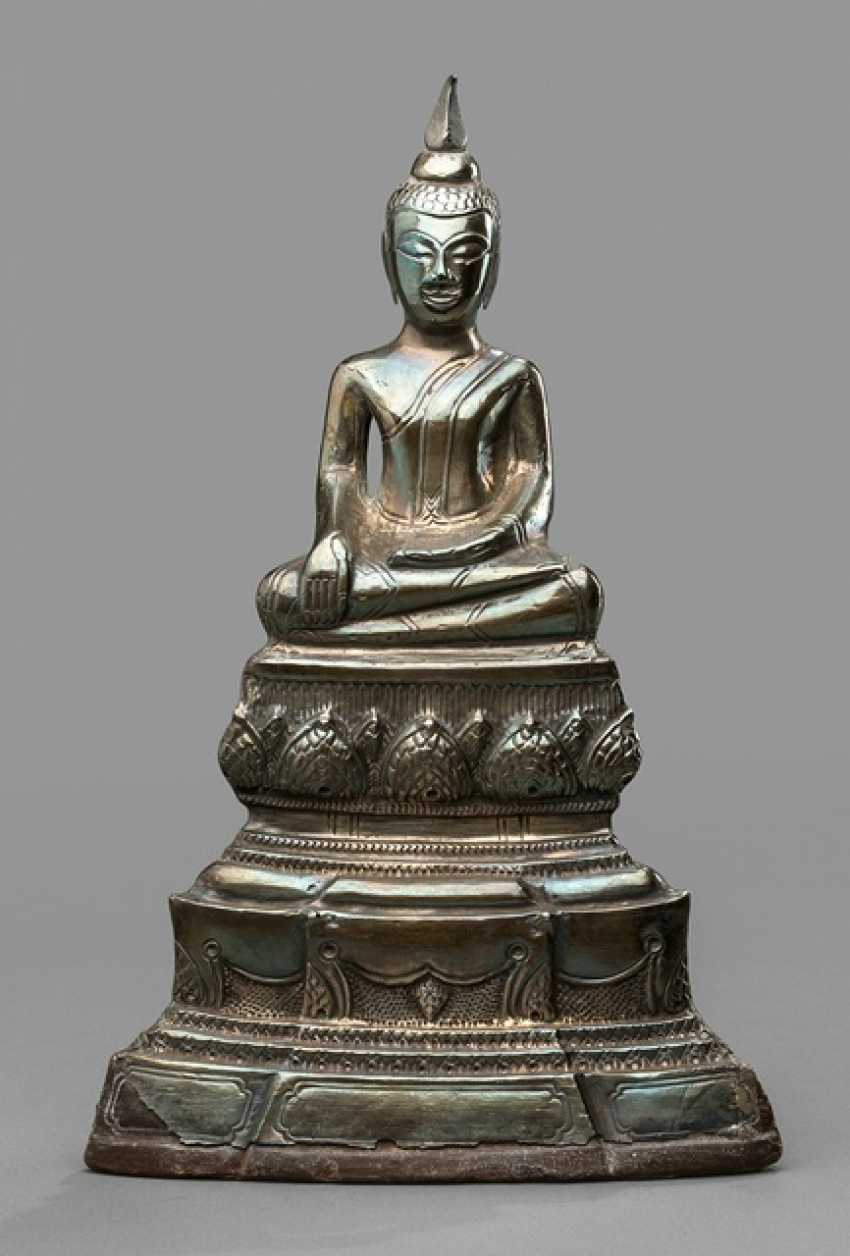 Sculpture of the Buddha Shakyamuni with silver outfit in the meditation seat - photo 1