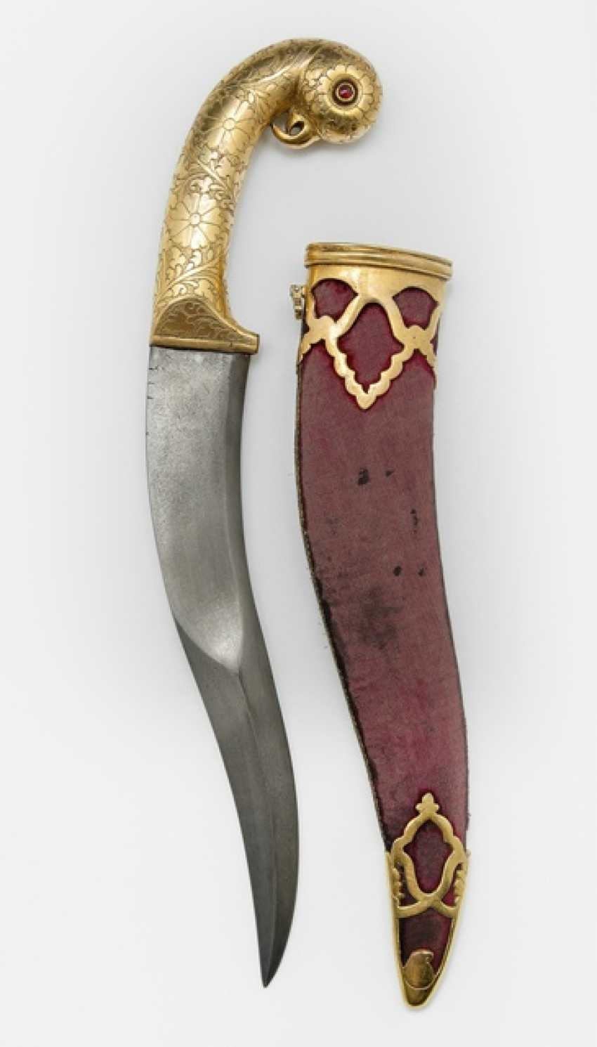 Dagger with steel blade and handle with a parrot head and ruby eyes, fire gilt, scabbard - photo 1