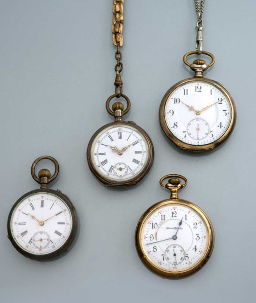 Group of four pocket watches - photo 1