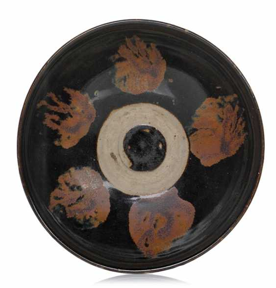 Bowl with rust-brown stains on the black-brown rear - photo 1