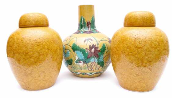 Pair of yellow glazed lid vases and a yellow basis bottle vase with Lotus decor - photo 1