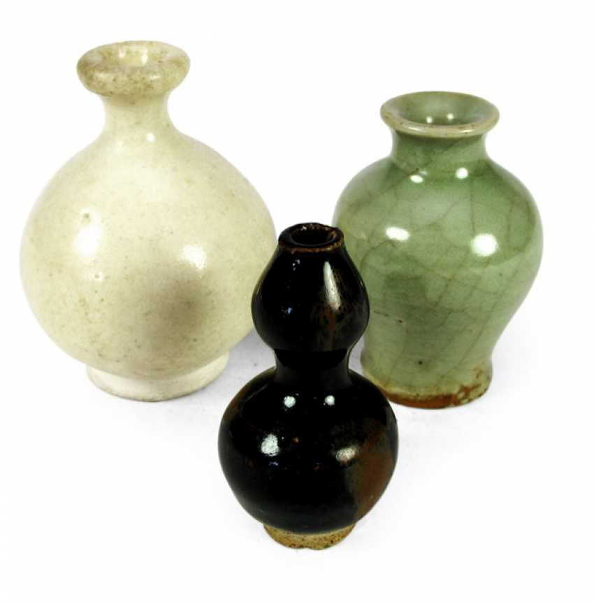 Three different, mostly monochrome glazed miniature vases porcelain - photo 1