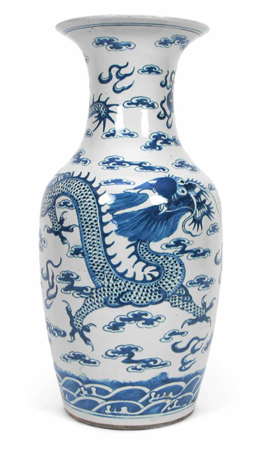 Under glaze blue Vase made of porcelain with decor of a dragon between clouds - photo 1