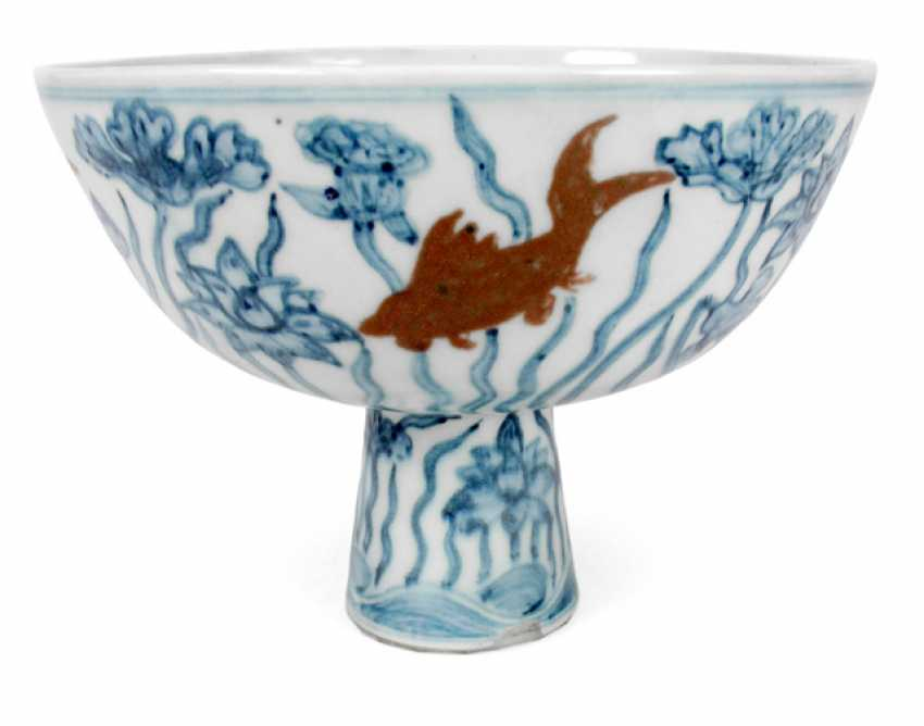 Under glaze blue Stemcup made of porcelain with a Lotus décor and red fish - photo 1
