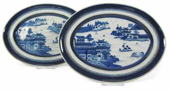 Pair of underglaze blue Oval platters with a river landscape and architecture - photo 1