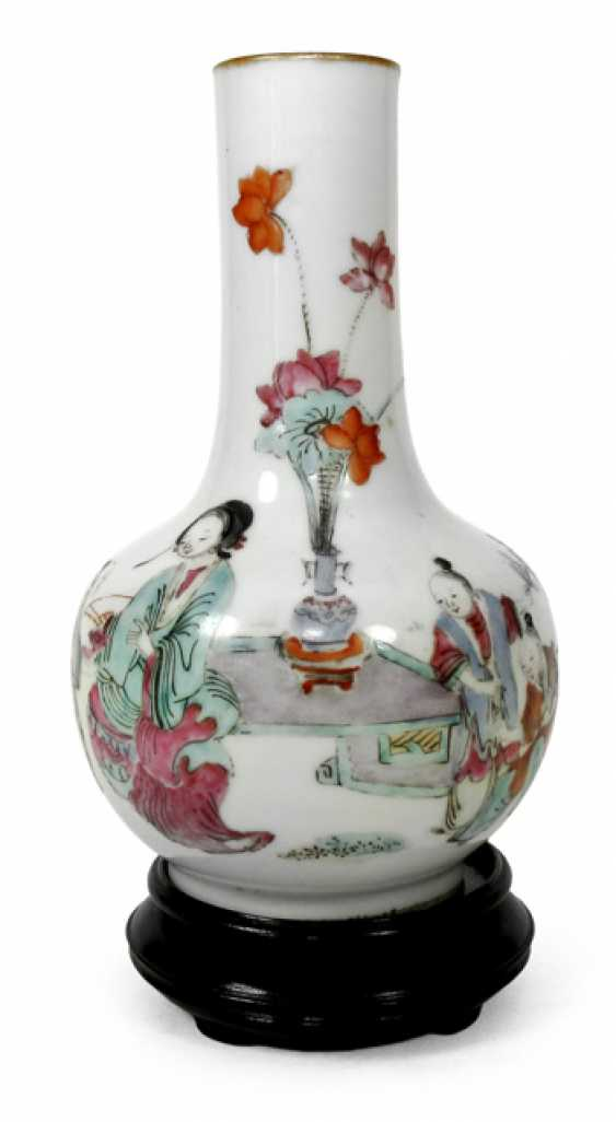 Polychrome decorated bottle vase made of porcelain with a figure decor - photo 1
