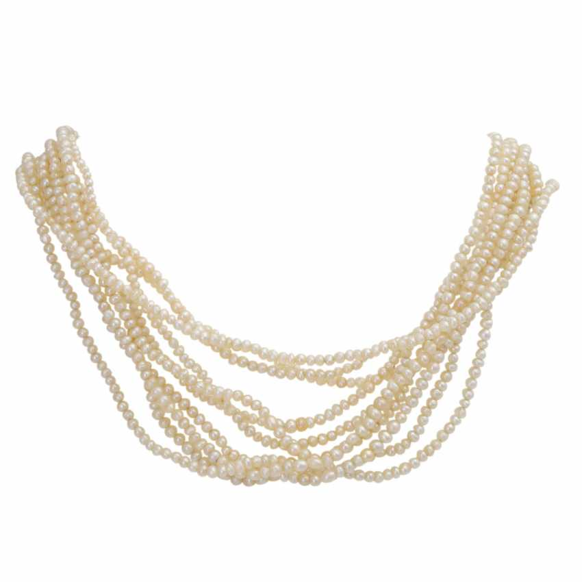 Lot 307  A multi-row necklace made of natural pearls from the