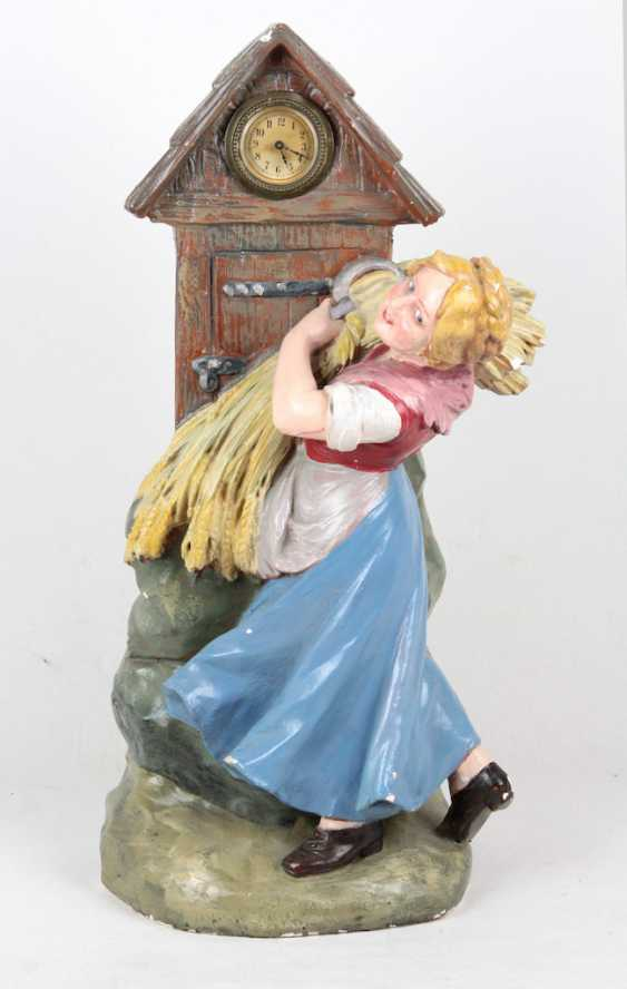 large plaster figure with clock - photo 1