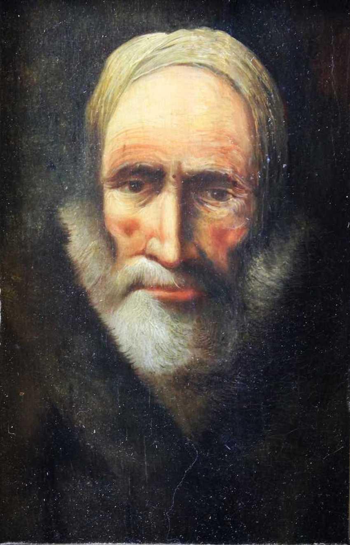Portrait of a bearded man in a fur coat - photo 1
