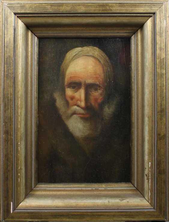 Portrait of a bearded man in a fur coat - photo 2