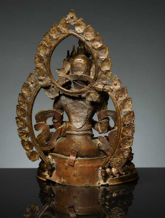 BODHISATTVA IN FRONT OF A DOUBLE NIMBUS