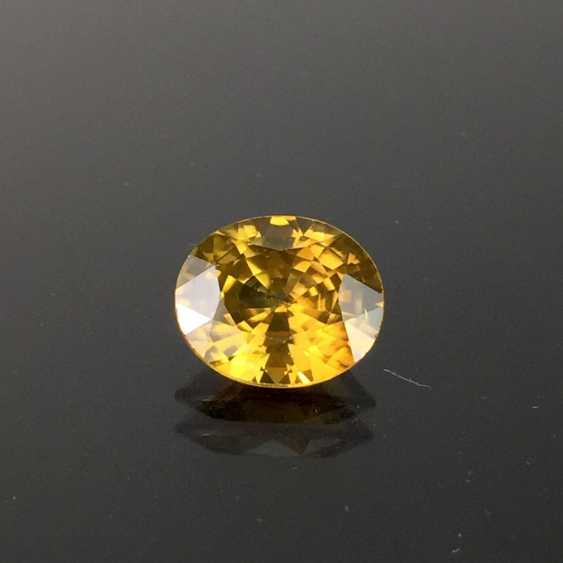 Yellow / gold yellow natural Zikon, oval, faceted, untreated, 5,1 carat, excellent. - photo 1