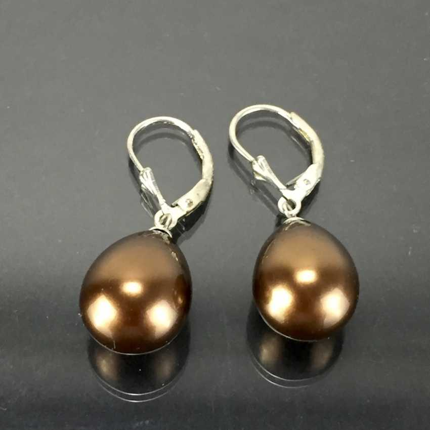 Elegant earrings: silver 925, rhodium plated, with drop-shaped pearl, very nice. - photo 1