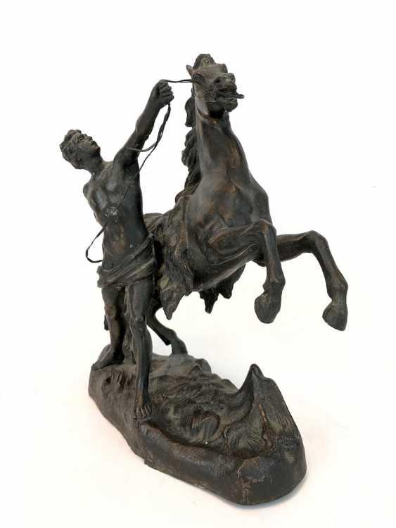 Stallion with a slave. Kupferguß, 1900. - photo 1