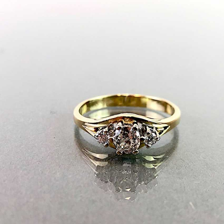 Ladies ring with diamonds: 0,3 carats and two 0.05 carat. Yellow gold 585. Very good. - photo 1