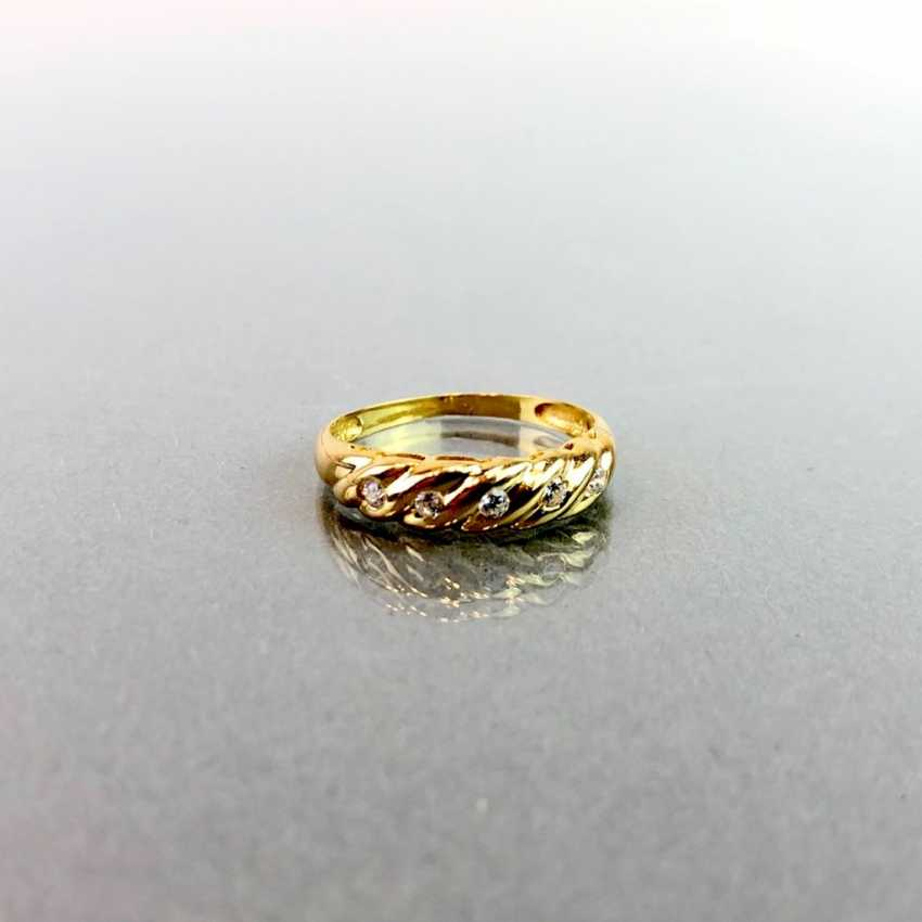 Lady's ring with five diamonds. Yellow gold 750. - photo 1