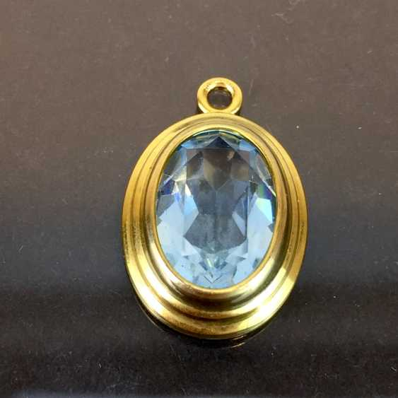 Simple and elegant pendant: yellow gold 333, oval Topaz. - photo 1