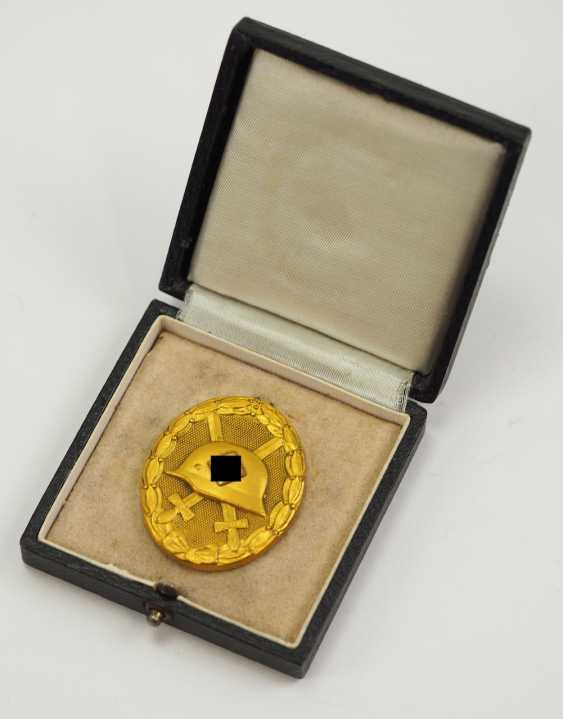 Wounded badge, 1939, Gold, in the case 30. - photo 1