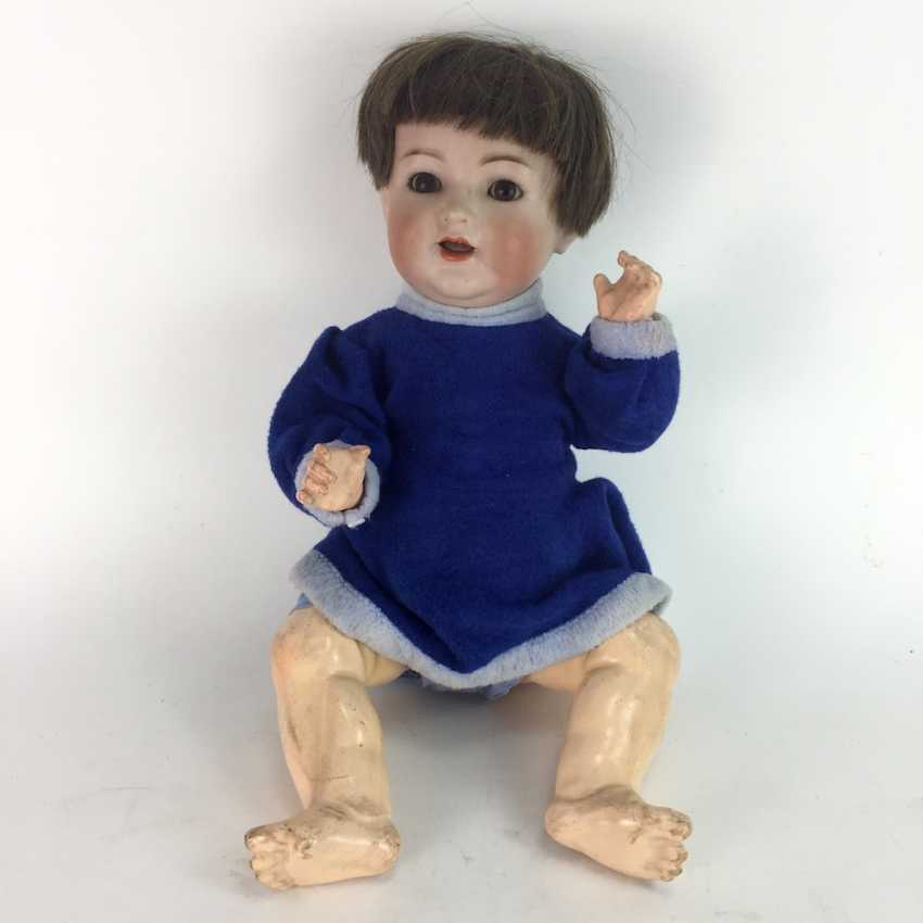 Porcelain head doll / jointed doll, marked K star R: Kämmer & Reinhardt, Simon and Halbig, no. 126, 1900. - photo 1
