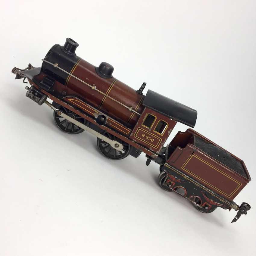 MÄRKLIN track 0, R950, Trailing tender locomotive, maroon/black, clockwork intact, with Tender R959, more followers, and rails. - photo 1