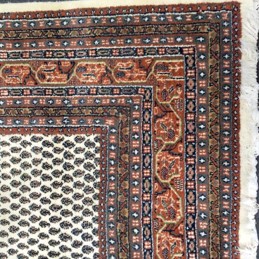 Great rug, bright basic, stylized floral pattern border on both sides, blue/red border, wool, very good condition. - photo 2