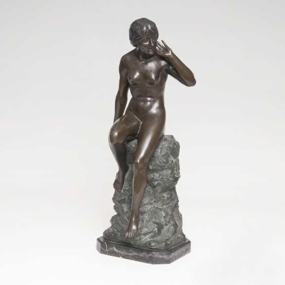 Figure 'Female Nude on a rock sitting' - photo 1