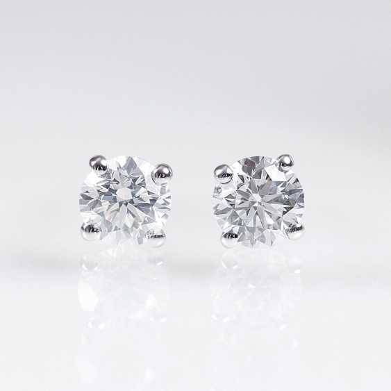 Pair of fine white solitaire stud earrings - photo 1