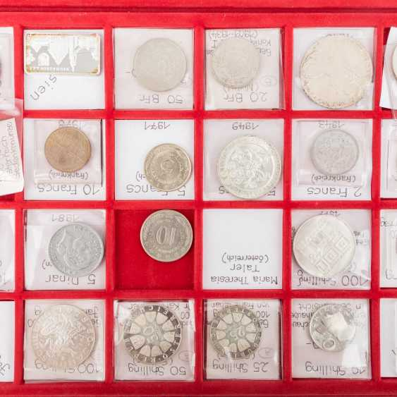 A number of coins from all over the world in 2 suitcases with SILVER - photo 3