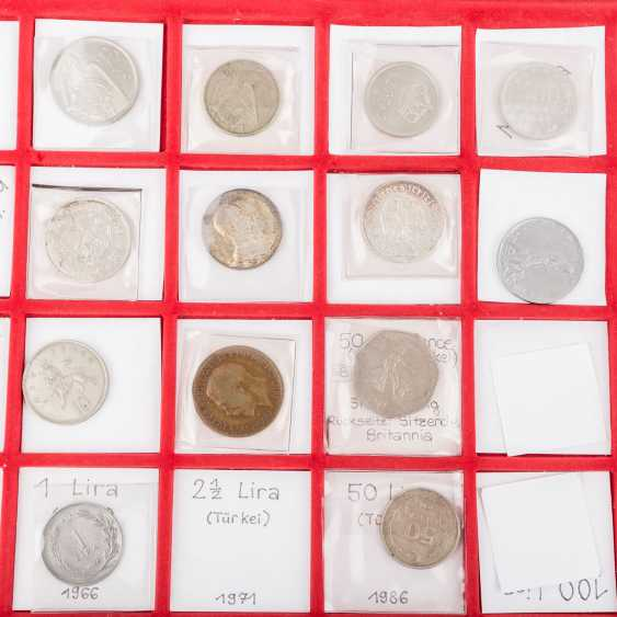 A number of coins from all over the world in 2 suitcases with SILVER - photo 4