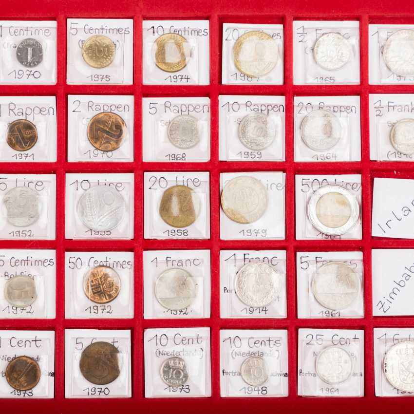 A number of coins from all over the world in 2 suitcases with SILVER - photo 6