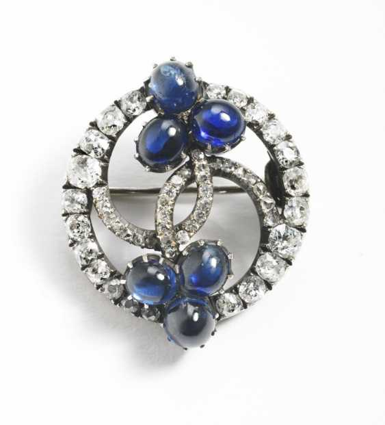 Edward Schramm, Faberge Russian Faberge Royal diamond and sapphire brooch, mounted in silver and gold. St Petersburg, 1890s. Diam. 2.5 cm