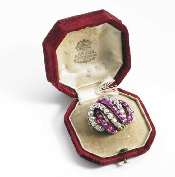 C. E. Bolin: A Russian ruby- and diamond brooch set with numerous oval-cut rubies and rose and old Europian-cut diamonds, mounted in 18k gold. C. 1900. (3). - photo 1