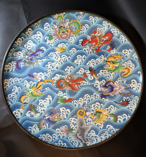 Large Asian cloisone plate with multicoloured enamel decorated with dragons