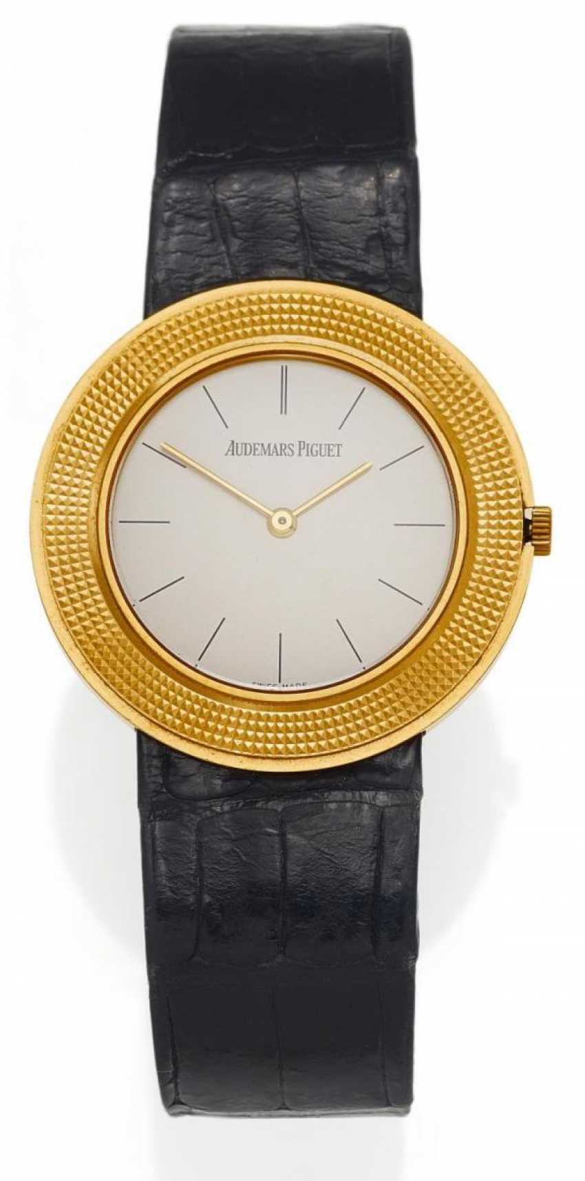 Men's watch. Hand lift. 750/- yellow gold - photo 1
