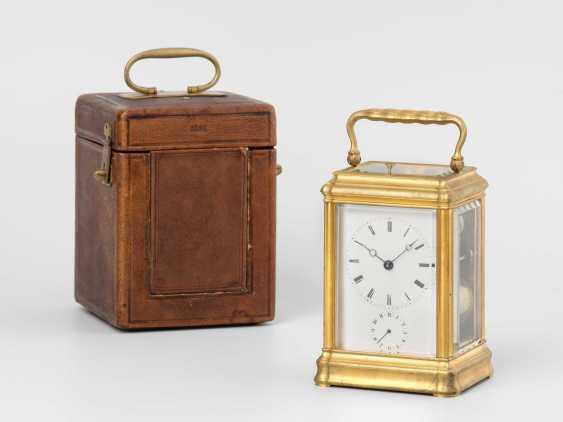 Travel alarm clock with leather box - photo 1
