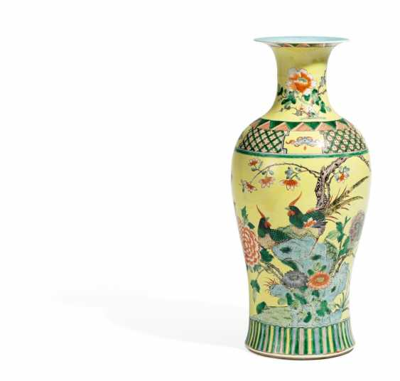 Vase with a couple of Pheasants in flowering peonies - photo 1