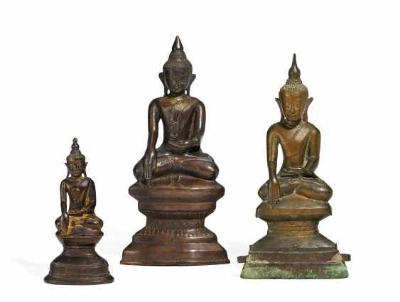 Three Buddha on high pedestals - photo 1