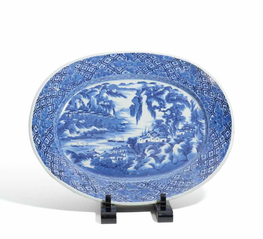 Large oval plate with a Chinese mountain landscape - photo 1