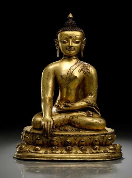 FINE FIRE-GILDED BRONZE OF THE BUDDHA SHAKYAMUNI