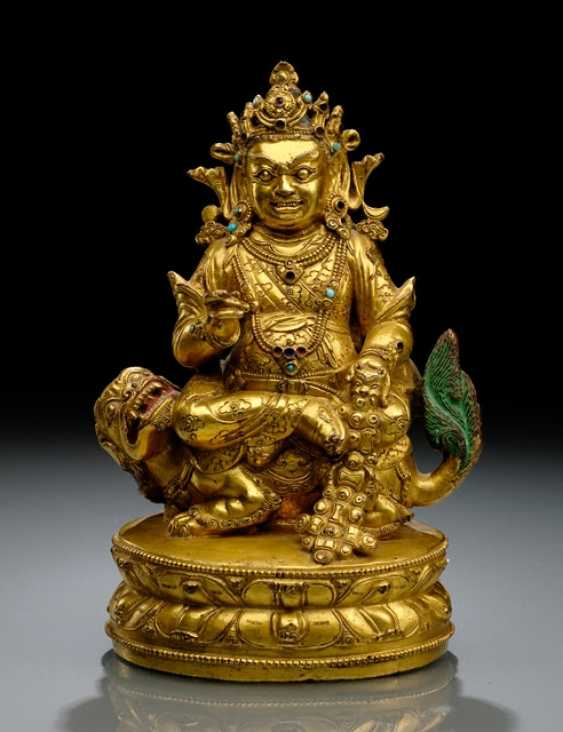 FINE AND RARE FIRE-GILT BRONZE VAISHRAVANA
