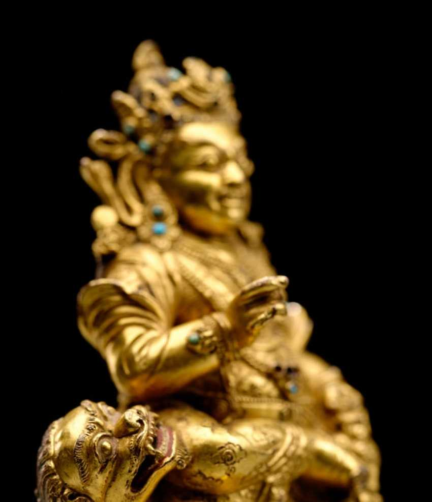 FINE AND RARE FIRE-GILT BRONZE VAISHRAVANA - photo 2
