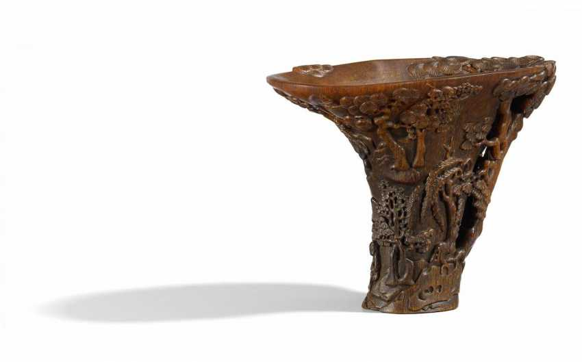 Elegant rhinoceros-Cup with a hermit in a landscape with tall pines - photo 2