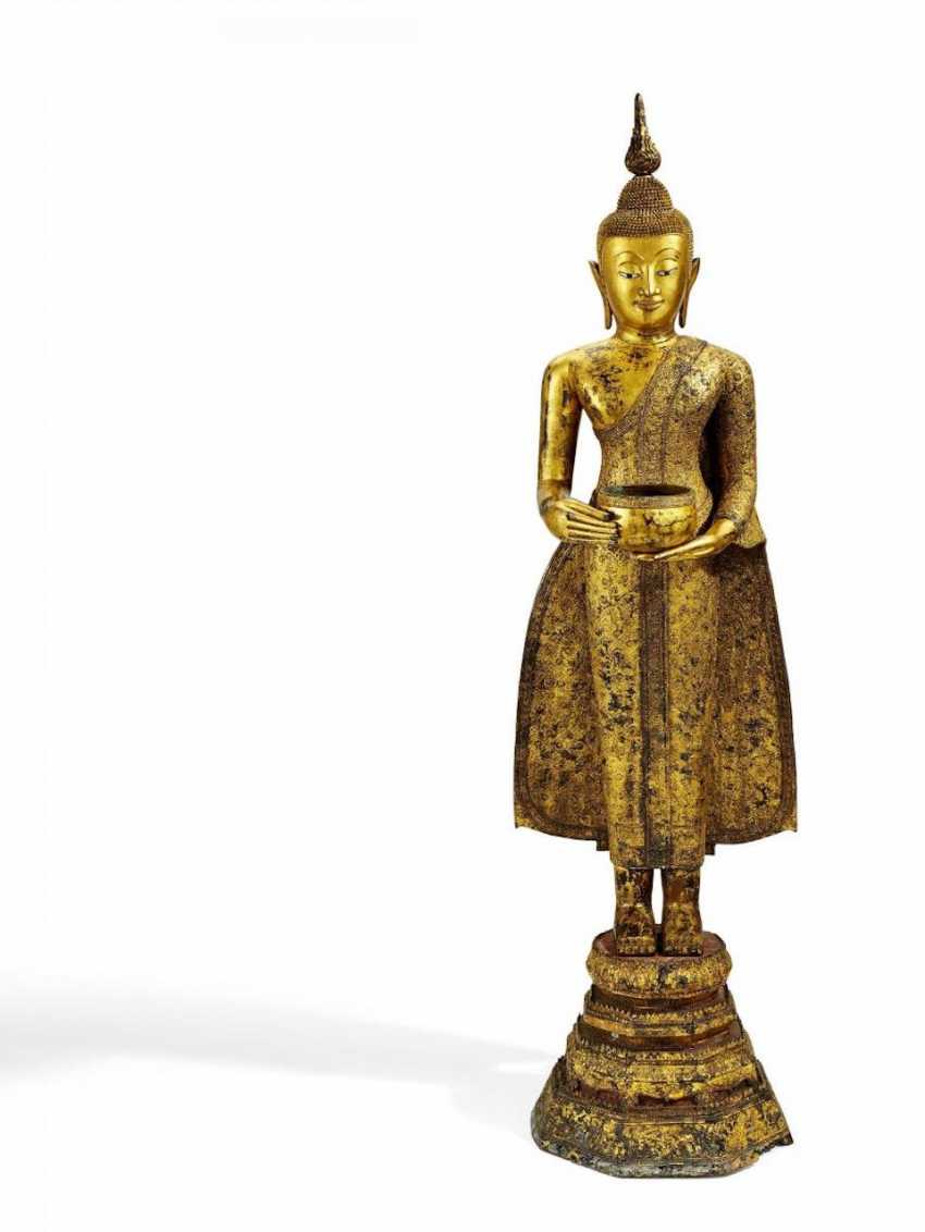 Large standing Buddha with alms bowl - photo 1