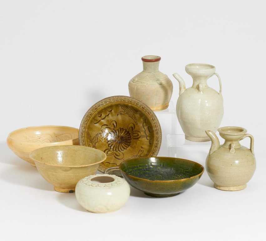 Four bowls and four vessels - photo 1