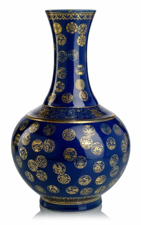 Powder-blue bottle vase made of porcelain with medallions in gold painting - photo 1