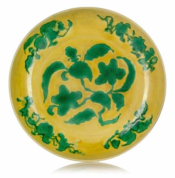 Large, yellow glazed porcelain bowl with green décor of gardenias and branches - photo 1