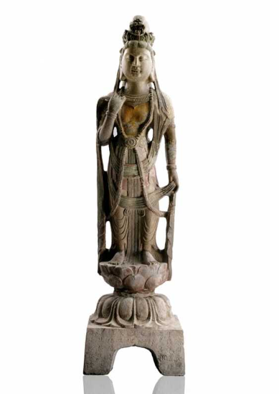 Large stone figure of Guanyin on a Lotus, part polychromic coloring