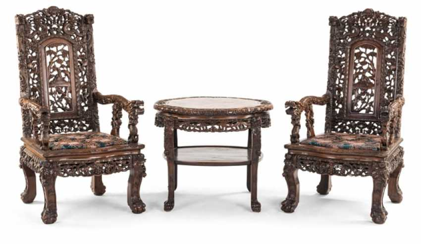 Two richly carved armchairs, side chairs, daybed, column, and table with marble top